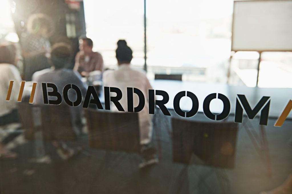 How you interact with your board.  Image of a group of young business colleagues in a boardroom meeting.